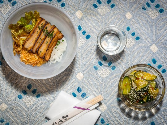 636457446259342034-TOKYO-RECORD-BAR-Dine on dishes like braised pork belly and spicy cucumbers during Tokyo Record Bar's intimate listening parties.