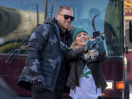 Philadelphia Eagles NFL football player Zach Ertz, left, stops to take a photo with his wife, Julie Ertz, during a Super Bowl victory parade, Thursday, Feb. 8, 2018, in Philadelphia. The Eagles beat the New England Patriots 41-33 in Super Bowl 52.