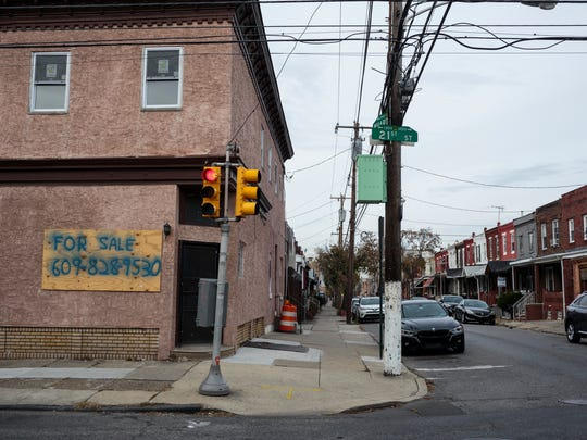 This Nov. 12, 2017, photo provided by Reveal shows Point Breeze neighborhood in Philadelphia. The Community Reinvestment Act of 1977 was designed to correct the damage of redlining, a now-illegal practice in which the government warned banks away from neighborhoods with high concentrations of immigrants and African Americans. The law didn't anticipate a day when historically black neighborhoods would be sought out by young white homebuyers.