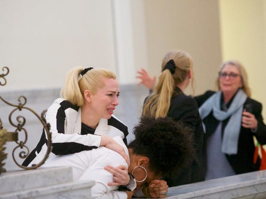 Bill Cosby accusers (L-R) Caroline Heldman, Lili Bernard and Victoria Valentino (far right) react after the guilty on all counts verdict was delivered in the Cosby retrial.