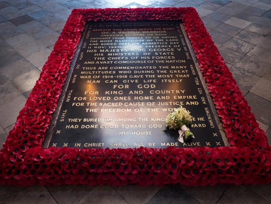 The bouquet of flowers carried by Meghan Markle during her wedding to Britain's Prince Harry, Duke of Sussex at St. George's Chapel, Windsor Castle, is pictured on the grave of the Unknown Warrior inside Westminster Abbey in London.