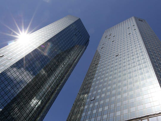 In this file photo taken on April 26, 2018, the towers of German financial giant Deutsche Bank are pictured in Frankfurt am Main, western Germany.