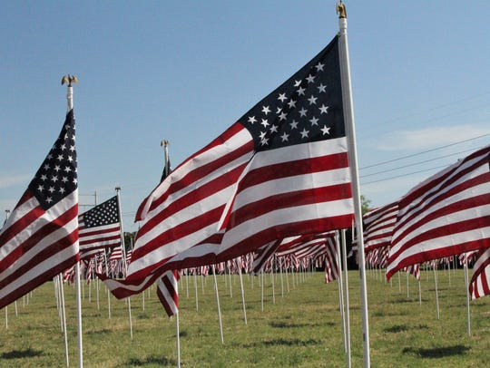 Flags flap in the late spring breeze Memorial Day,