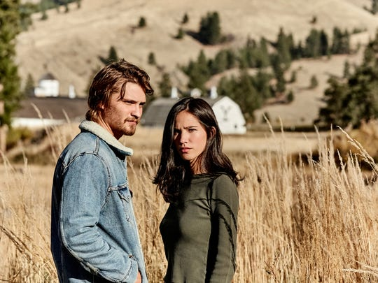 """This image released by Paramount Network shows Luke Grimes, left, and Kelsey Asbille from the series """"Yellowstone"""" premiering Wednesday, June 20."""