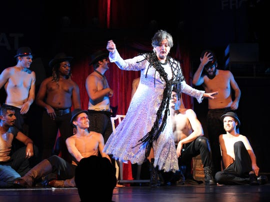 """Betty Hukill, as Berthe, the saucy grandmother of Pippin, sings """"No Time At All"""" surrounded by a stage full of shirtless men. Hukill's performance drew great applause at performances of """"Pippin"""" last weekend at the Paramount Theatre, where she retired June 1 as executive director."""