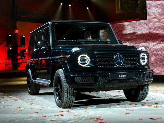 Mercedes g class lights up michigan theater ruin for Buy mercedes benz g class
