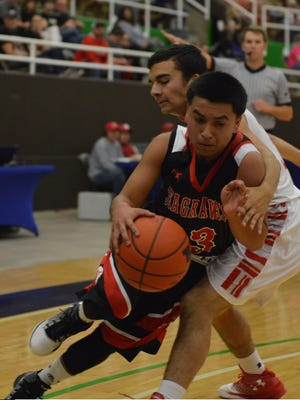 Seagraves' Davin Rodriguez drives to drive around Albany's Roman Fuentes in the first half of Tuesday's 2A regional quarterfinal in Snyder.