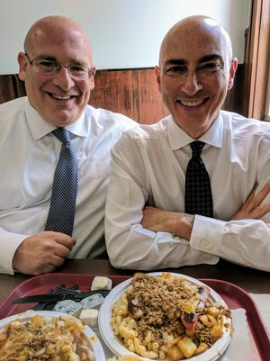 Tennessean columnist Brad Schmitt, left, and his older brother, Scott, enjoy Garbage Plates from Nick Tahou's in Rochester, New York.