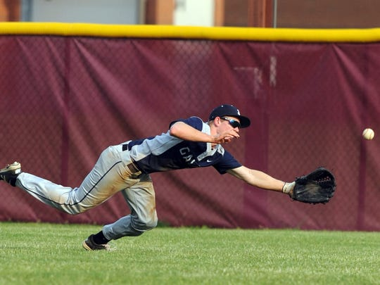 Lancaster center fielder Chris Meszaros dives for a ball during Wednesday's playoff game, May 10, 2017, at Canal Winchester High School in Canal Winchester. The Golden Gales lost the game 4-3.