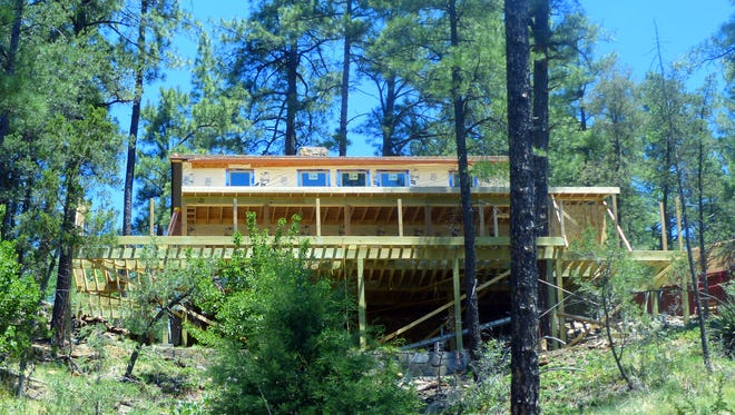 A large deck and addition are under construction at this home.