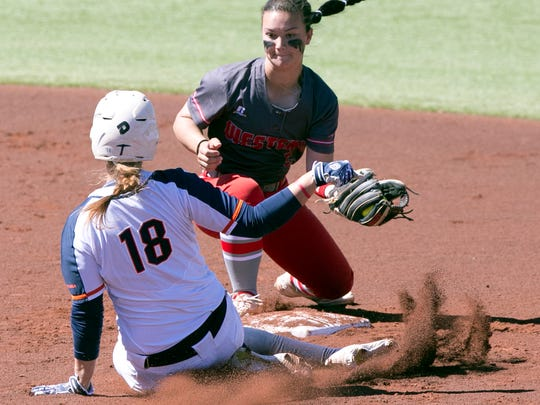UTEP baserunner Mallorie Cross, 18, slides into second base as Western Kentucky shortstop Brittany Vaughn readies the tag Saturday at Helen of Troy softball complex. Cross was ruled safe on the play.