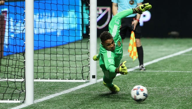 Columbus Crew goalkeeper Zack Steffen makes a save during the shootout against Atlanta.