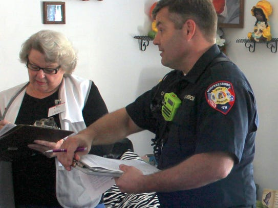A Red Cross volunteer assists Captain/Shift Inspector
