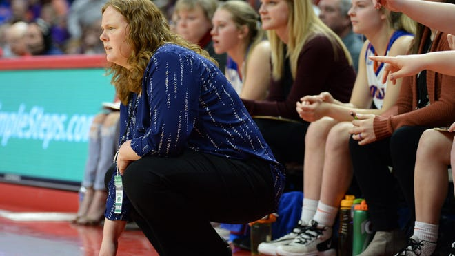 """Eastland coach Nicole Brinker, left, who led the Cougars to the 2020 Class 1A state girls basketball title, said she was """"blind-sided"""" by Gov. JB Pritzker's moves Tuesday and Thursday to shut down or delay the high school basketball seasons."""