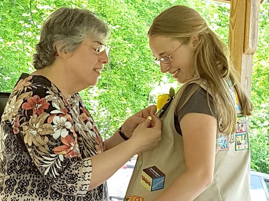 The Girl Scout Gold Award was presented to Liz Coover by Senior Troop leader Becky Stabler.