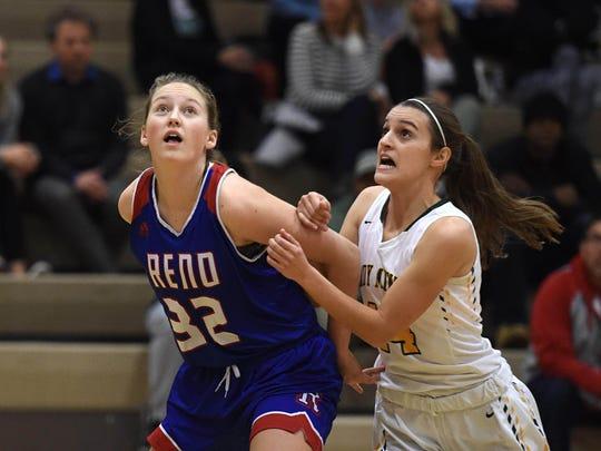 Reno's Gracen McGwire, left, and Manogue's Hannah Reviglio look for a rebound at Bishop Manogue on Dec. 12.