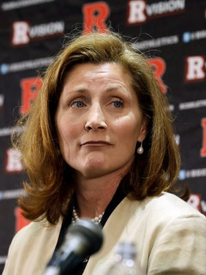 In this Wednesday, May 15, 2013 file photo, Julie Hermann listens during a news conference where she was introduced as the new athletic director at Rutgers University, in Piscataway, N.J.