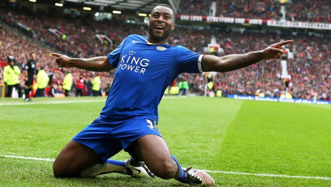 Leicester City's Wes Morgan celebrates after scoring the 1-1 equalizer during the English Premier League soccer match between Manchester United and Leicester City.