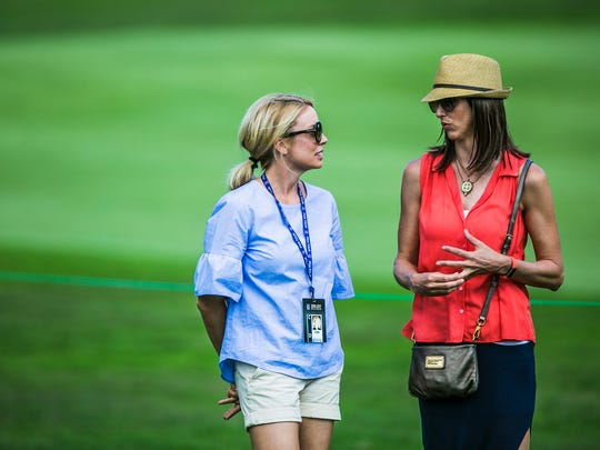 June 10, 2017 - Heather Crane (left), wife of golfer Ben Crane, and Lisa Cink, wife of golfer Stewart Cink, converse as their husbands compete during the third round of the 60th annual FedEx St. Jude Classic at TPC Southwind in Memphis on Saturday. Lisa Cink is currently in remission from her battle with cancer.