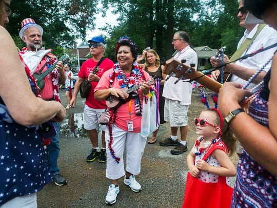 "July 4, 2017 - Amelia Callicott, center, with the Memphis Ukulele Flash Mob, practices ""This Land is My Land"" with her group at Peabody Elementary School as they prepare for Cooper Young's Fourth of July parade on Tuesday."