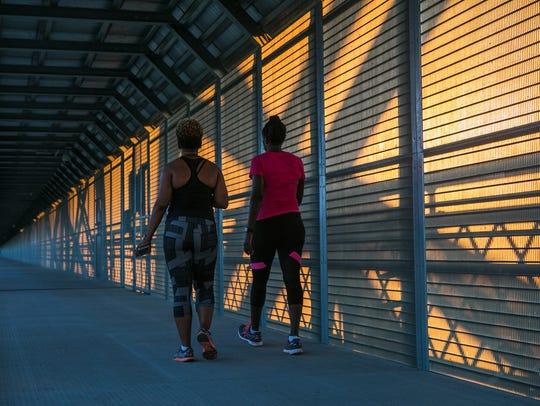 August 10, 2017 - Walkers exercise on the Harahan Bridge