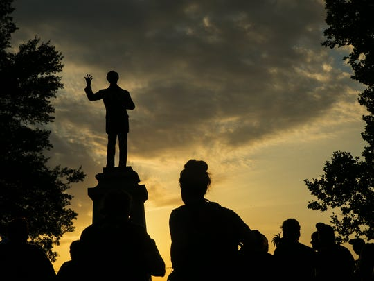 "Protesters surround the Jefferson Davis Confederate statue at Memphis Park on Aug. 15, 2017. The action comes days after the death of Heather Heyer after the ""Unite the Right"" rally in Charlottesville, Virginia. ""We cannot celebrate MLK 50 with these statues in our city,"" said activist Tami Sawyer."