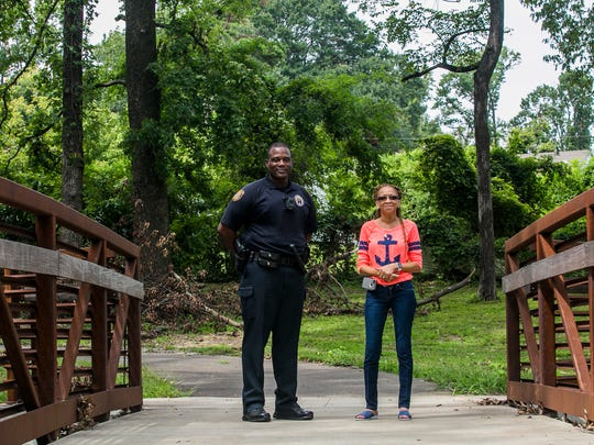 "August 23, 2017 - Memphis police officer Clayton Turner, of the Community Outreach Program (COP) and Debra Lovelace, president of the Denver Park Neighborhood Association, stand in Denver Park, located in Frayser. At one point, COP was heavily concentrated in the Frayser community but has since moved to other areas in Memphis. ""Along with the COP program, the Denver Park Neighborhood Association and the residents of this area, and all of the other agencies or organizations in Frayser ... we all got together to go to City Hall and asked them to renovate this park for us. We just actually worked real hard to get the park and when we got it, it was so beautiful. It was like a dream. And then all of a sudden it just like turned back into a nightmare,"" Lovelace said. ""It's sad really. They (the city) moved our COP program; they're not able to work with us like they did. I guess we're not important other here. I don't know, we're trying and we want better."""