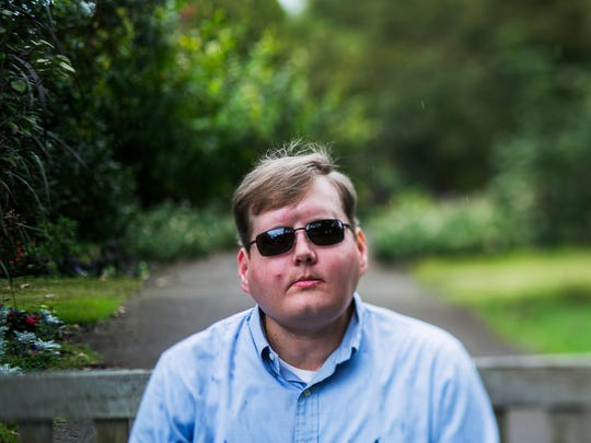 """Face transplant recipient Pat Hardison, 43, poses for a portrait before speaking at the Mid-South Transplant Foundation's annual """"Celebration of Life"""" event at the Memphis Botanic Garden on Oct. 22, 2017. The Senatobia, Miss., volunteer fireman was burned beyond recognition while fighting a house fire Sept. 5, 2001."""
