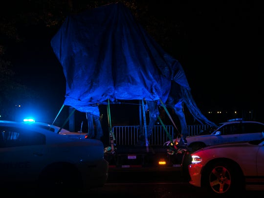 December 20, 2017 - Nathan Bedford Forrest's Confederate statue is removed from Health Sciences Park on Wednesday night.