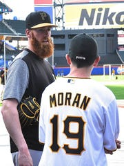 Colin Moran chats with cousin Ryan Surhoff prior to