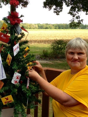 Pam Carman, soup kitchen director for Spirit & Truth Ministries in Vineland, shows off a gift card tree that will be raffled off at the organization's bingo event on Oct. 23 in Millville.