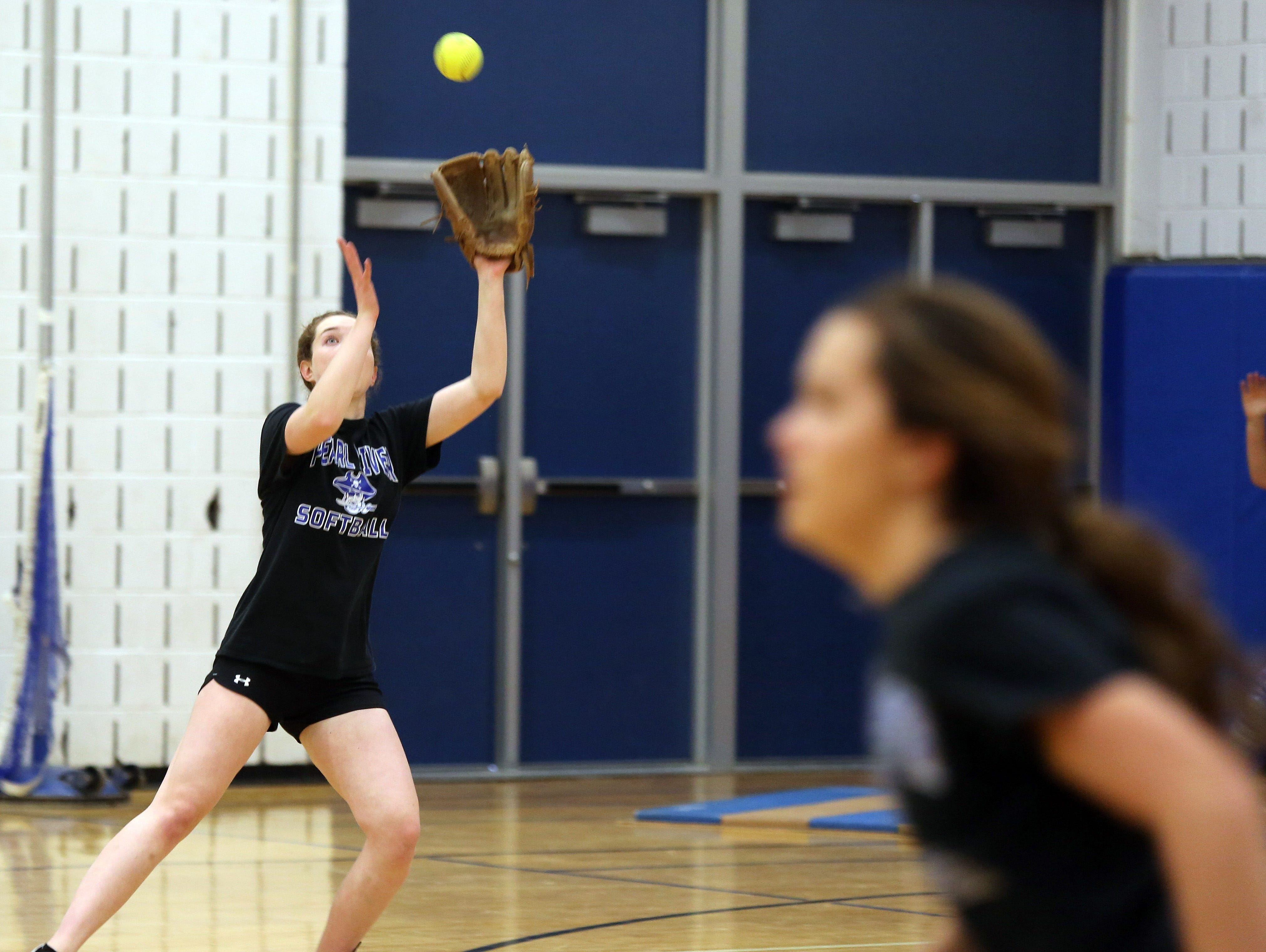 Emily Turilli catches the ball during girls softball practices in the gym at Pearl River high school on March 14, 2016.