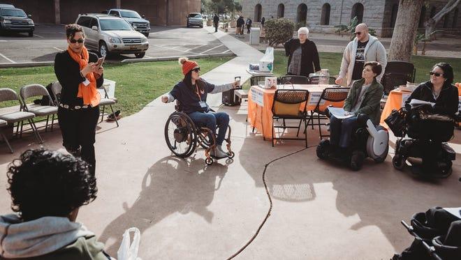Gina Schuh, president of Accessible Arizona, speaks outside the Arizona Capitol.