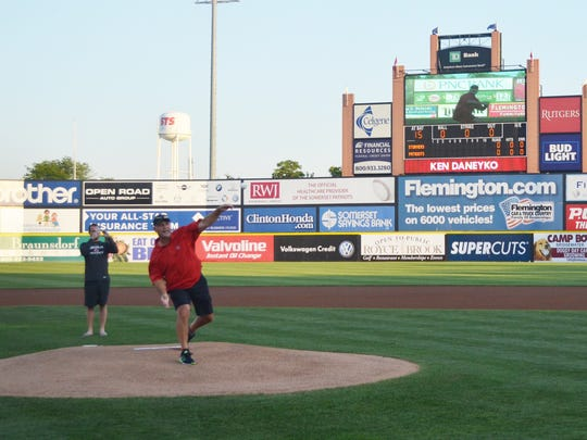 Ken Daneyko, a legendary defenseman for the New Jersey Devils, throws out the ceremonial first pitch Wednesday night at TD Bank Ballpark in Bridgewater.