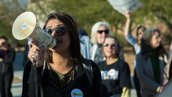 Johana Bencomo a community oganizer with NM CAFé, leads a group of protesters in chants as they blocked traffic on Griggs and Church Street Wednesday, February 15, 2017. The press conference held by NM CAFé and following protest was in response to Ice raids that occurred earlier Wednesday in Las Cruces.