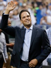 Former New York Mets player Mike Piazza gestures to fans before a ceremony to retire his jersey number before a baseball game between the Mets and the Colorado Rockies at Citi Field Saturday, July 30, 2016, in New York. (AP Photo/Frank Franklin II)