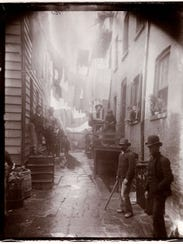 """This photo from Jacob A. Riis is titled """"Bandits' Roost."""""""