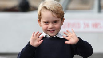 Prince George of Cambridge waves as he leaves Victoria, B.C., Canada on October 1, 2016.