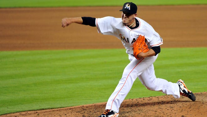 Miami Marlins starting pitcher Jose Fernandez throws the ball against the Atlanta Braves during the fourth inning at Marlins Ballpark.