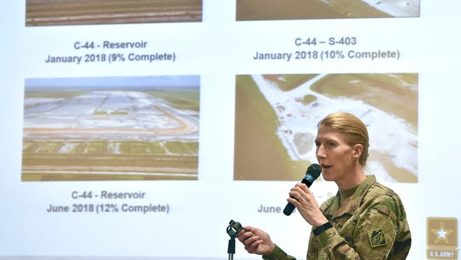 Lt. Col. Jennifer Reynolds, Deputy District Engineer for South Florida, from the U S Army Corps of Engineers, discusses photos of the C-44 Reservoir at the end of her presentation on Lake Okeechobee and the St. Lucie River during a Rivers Coalition meeting Thursday, June 28, 2018, at the City of Stuart commission chambers. More than 100 attended the 90-minute meeting, providing an update to the public on the algae situation affecting Lake Okeechobee and the St. Lucie River.