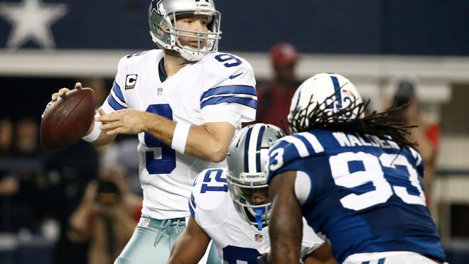 Cowboys quarterback Tony Romo (9) prepares to pass as running back Joseph Randle (21) picks up the pressure from Colts outside linebacker Erik Walden during Sunday's game in Arlington, Texas.