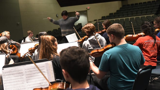 Executive Director Newark-Granville Symphony Orchestra Susan Larson conducts the youth orchestra during a rehearsal on Tuesday, Feb. 6, 2018.