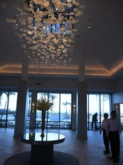 A new chandelier graces the lobby. The Hilton Marco