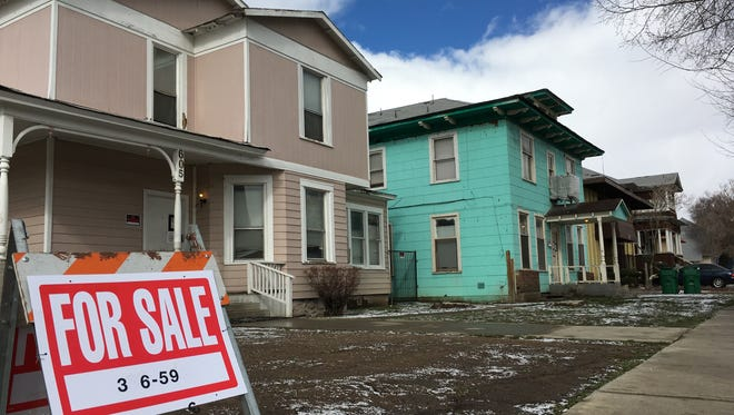 On Center and Sixth streets, old boarded up homes that were going to be demolished for student housing are now for sale.