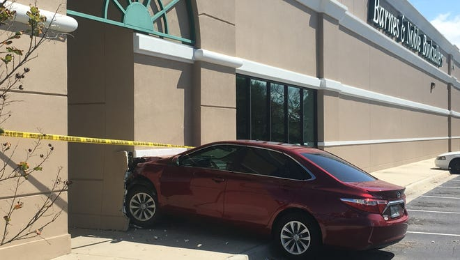 No one was seriously hurt when a car crashed through a wall at Barnes & Noble in West Melbourne.