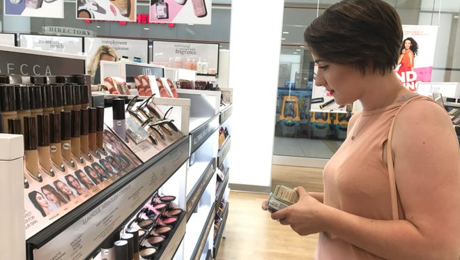 Katelyn Farris, 19, of Sumrall shops Monday at Ulta, now open at Turtle Creek Mall.
