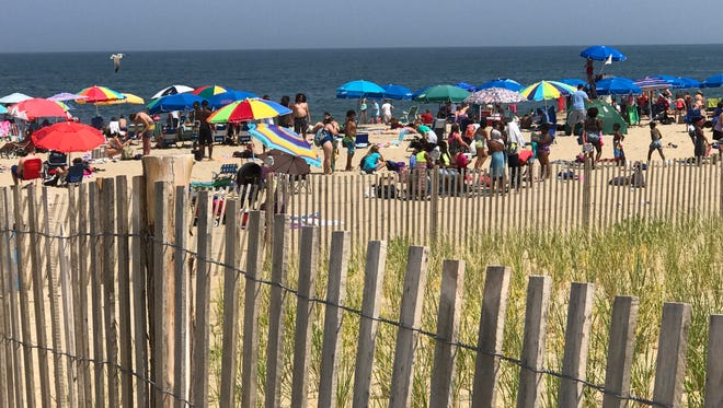 Umbrellas line Rehoboth Beach nearly two months after the tent and canopy ban went into effect. Seen July 14, 2017.