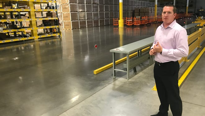 John Kutz, senior manager of the Volkswagen Southeast Regional Distribution Center, stands in the Roane County facility's parts warehouse.