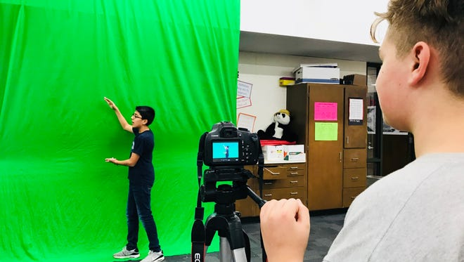 Students in the Tech Ninjas flex class at Cudahy Middle School film an episode of the Bulldog Bark, a weekly news show, using green screen technology.