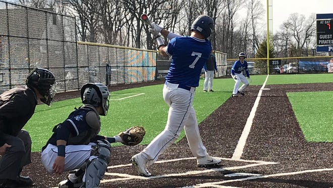 Millburn's Peter Serruto (7) attempts to knock in a run against Seton Hall Prep.